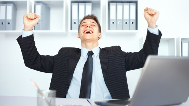 Employee-at-desk-happy-about-career-success