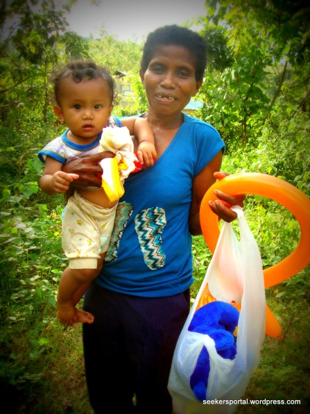 A Happy Mother and Child with our Gift of Goodies
